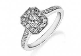 Phoenix Cut™ Rubover set ring surrounded with pave brilliant cut diamonds